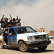 Members of Moqtada al Sadr's Mehdi army in a stolen police truck on the streets of Najaf on the 15th April 2004.