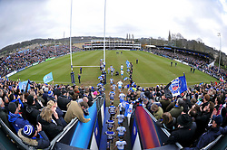 The Bath Rugby and Glasgow Warriors teams run out onto the field for the start of the match - Photo mandatory by-line: Patrick Khachfe/JMP - Mobile: 07966 386802 25/01/2015 - SPORT - RUGBY UNION - Bath - The Recreation Ground - Bath Rugby v Glasgow Warriors - European Rugby Champions Cup