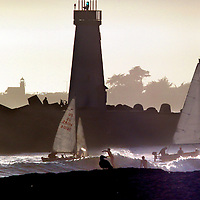 Both Santa Cruzl lighthouses are visible in the late afternoon sun as sailboats, surfers and seagulls converge at the mouth of the Santa Cruz Small Craft Harbor on February 2.<br />Photo by Shmuel Thaler/Santa Cruz Sentinel