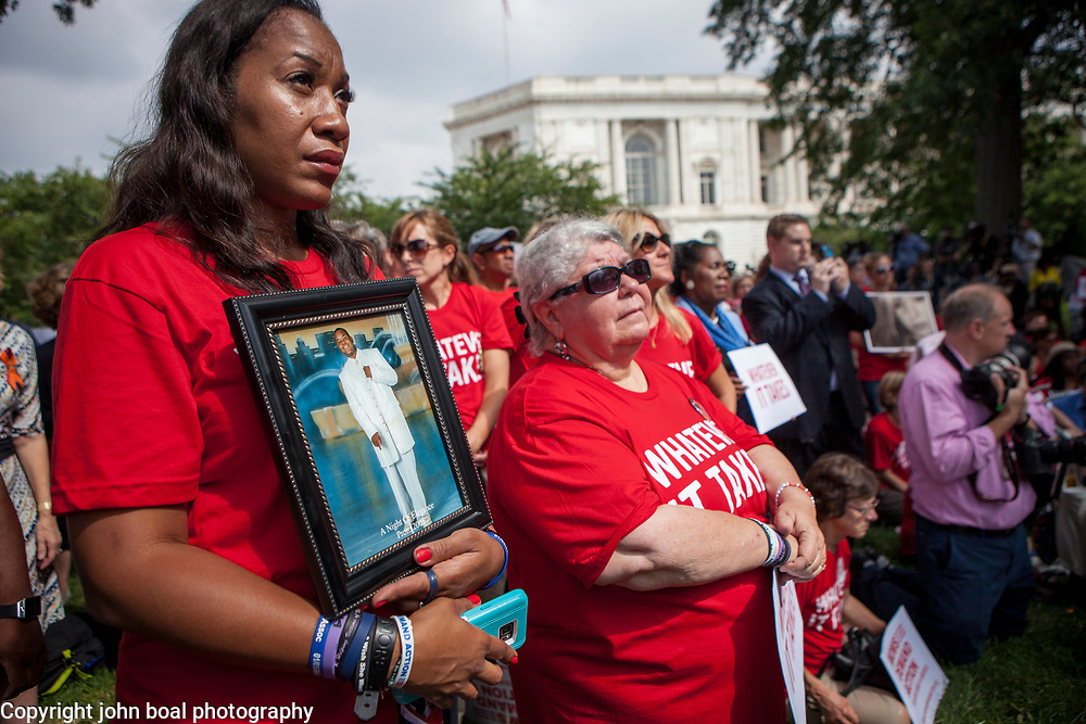 "Pam Bosley holds a framed picture of her son, Terrell Bosley, 18, who was a fatal victim of gun violence in Chicago, during a rally organized to support victims of gun violence and pressure politicians to do ""whatever it takes"" to prevent gun violence.  Andy Parker, made his first visit to Washington, D.C. since his daughter, WDBJ_TV reporter, Alison Parker, was shot and killed on live television near Roanoke, VA last week.  The rally, organized by Everytown for Gun Safety, brought Parker together with Virginia Senators, Mark Warner, Tim Kaine and Virginia Governor, Terry McAuliffe near the United States Capitol, on Thursday, September 10, 2015.  John Boal/for The New York Daily News"
