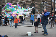 France. Paris 1st district.  Palais royal square ,man making giant soap bubbles /bulles de savon geantes , place du palais royal , paris
