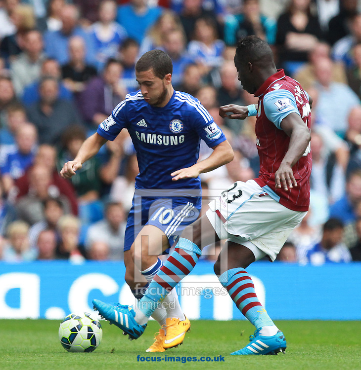 Eden Hazard of Chelsea and Aly Cissokho of Aston Villa during the Barclays Premier League match at Stamford Bridge, London<br /> Picture by John Rainford/Focus Images Ltd +44 7506 538356<br /> 27/09/2014