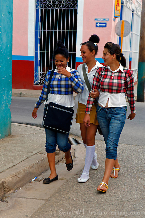 Central America, Cuba, Remedios. THree Cuban girls walking in street in Remedios.