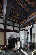 Oiso, Kanagawa prefecture, Japan, February 10 2017 - Keiji and Atsuko Suzuki's minka, traditional wooden house, is the last minka home in Oiso. The previous owner of the 3,000 sq. ft. house moved it from the shores of Lake Biwa, near Kyoto, 35 years ago.<br /> Living rooms.