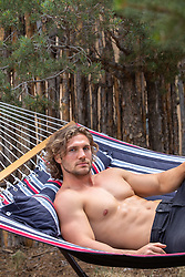sexy shirtless man in a hammock
