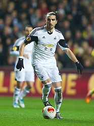 SWANSEA, WALES - Thursday, February 20, 2014: Swansea City's Chico Flores in action against SSC Napoli during the UEFA Europa League Round of 32 1st Leg match at the Liberty Stadium. (Pic by David Rawcliffe/Propaganda)