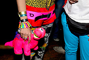 Namalee Bolle wearing New Rave styles, holding a cuddly toy dinosaur, Anti-Social, London December 2006