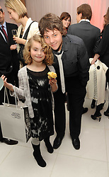 ROMANA MARQUEZ and TYGER DREW-HONEY at the launch of the English National Ballet's Christmas season 2009 held at the St.Martin;s Lane Hotel, London on 15th December 2009.