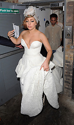 Lady Gaga wearing a gold crown and white dress enjoys a night out at The Arts Club in Mayfair, London, UK. 09/09/2012<br />