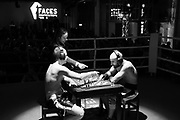 Amateur Chessboxers Daniel Biman (left) and Mohamad Khadijah are engaged in a round of chess during a chessboxing match at the Intellectual Fight Club in Berlin, Germany on the 15th of December 2017. <br />