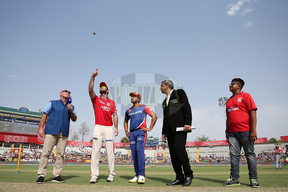 Kings XI Punjab captain Glenn Maxwell tosses the coin as Delhi Daredevils captain Karun Nair calls and Match Referee Sunil Chaturvedi looks on during match 36 of the Vivo 2017 Indian Premier League between the Kings XI Punjab and the Delhi Daredevils held at the Punjab Cricket Association IS Bindra Stadium in Mohali, India on the 30th April 2017<br /> <br /> Photo by Shaun Roy - Sportzpics - IPL