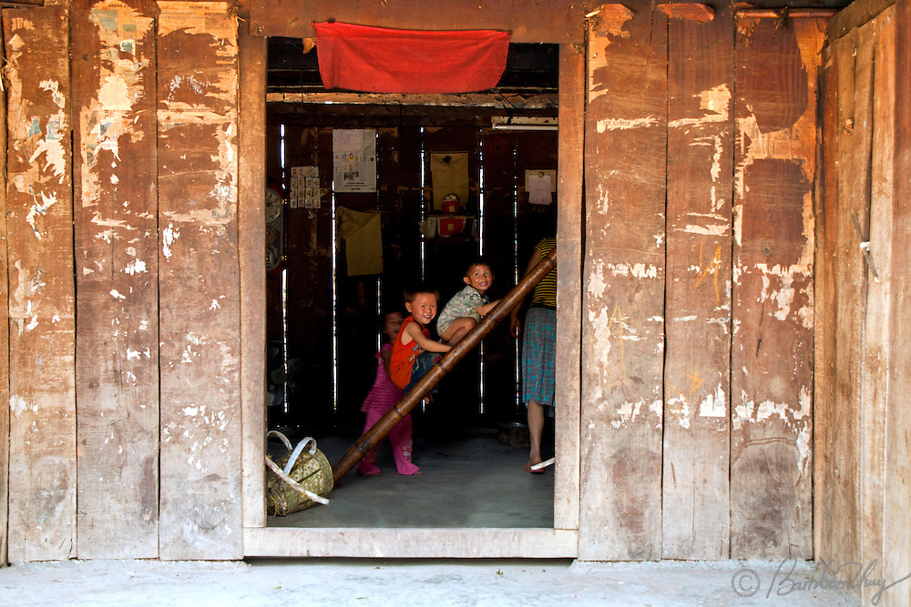 Children are playing in the house of minitary ethnics on the highland of Vietnam.