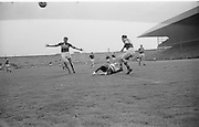 Players fall to ground during the All Ireland Senior Football Final Galway v. Kerry in Croke Park on the 26th September 1965. Galway 0-12 Kerry 0-09.