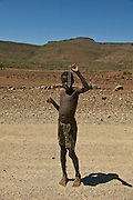 Africa, Namibia - boy offers Necklace for sale on road to Sesfontein