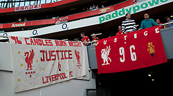 LONDON, ENGLAND - Sunday, April 17, 2011: Liverpool's supporters display a banner calling for Justice for the 96 victims of the Hillsborough Stadium Disaster '96 Candles Burn Bright' during the Premiership match against Arsenal at the Emirates Stadium. (Photo by David Rawcliffe/Propaganda)