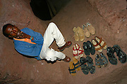 LALIBELA, WELO/ETHIOPIA..German journalist group leaving shoes before entering the famous rock-hewn churches, result of a delirious phantasy of King Lalibela, who had fallen into a coma due to a failed poisoning attack..(Photo by Heimo Aga)