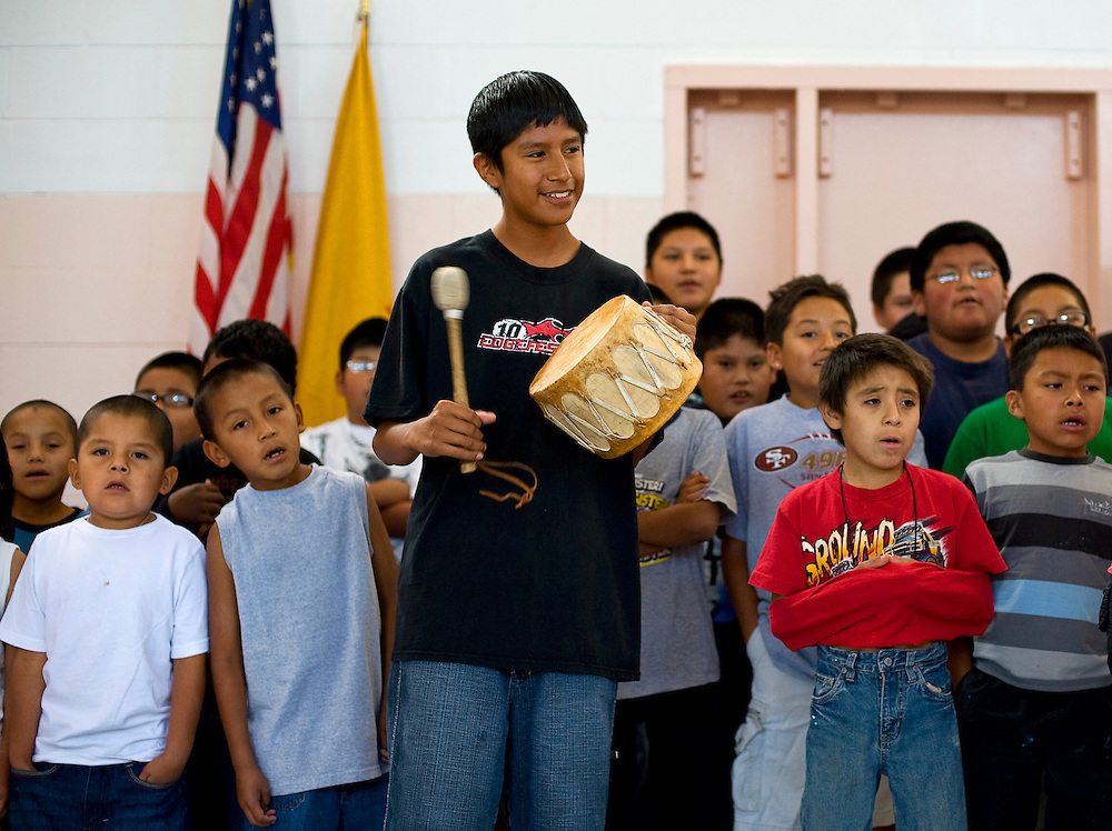 071509    Brian Leddy.Kerry Bobelu plays a drum during practice for a grand entry during the Zuni Culture Camp on Wednesday.The three-week camp is immerses students in the language and traditional customs of Zuni culture.