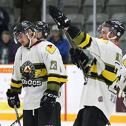 TRENTON, ON  - MAY 5,  2017: Canadian Junior Hockey League, Central Canadian Jr. &quot;A&quot; Championship. The Dudley Hewitt Cup Game 7 between Georgetown Raiders and the Powassan Voodoos.    Tyson Gilmour #23 and  Dayton Murray #20 of the Powassan Voodoos post game.<br /> (Photo by Alex D'Addese / OJHL Images)