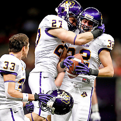 December 22, 2012; New Orleans, LA, USA; East Carolina Pirates linebacker James Craig (27) celebrates with teammate East Carolina Pirates defensive back Justin Venable (32) after he recovered a fumble on a kickoff against the Louisiana-Lafayette Ragin Cajuns during the second quarter of the New Orleans Bowl at the Mercedes-Benz Superdome. Mandatory Credit: Derick E. Hingle-USA TODAY Sports