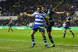 Adrian Popa of Reading under pressure from Derrick Williams of Blackburn Rovers - Mandatory by-line: Jason Brown/JMP - 04/04/2017 - FOOTBALL - Madejski Stadium - Reading, England - Reading v Blackburn Rovers - Sky Bet Championship