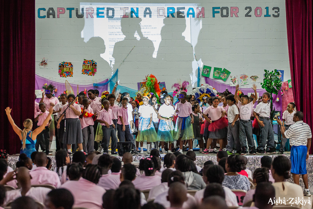 "Students perform ""The Yoga Song"".  Students at Gladys Abraham Elementary school perform ""A Blissful Quest for Unity"" written by art teacher Elise McCutcheon for their fellow students.  Students made their own costumes and set decorations with recycled materials for the performance.  Gladys Abraham Elementary school.  26 November 2013.  © Aisha-Zakiya Boyd"