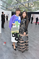 Left to right, GEORGIA COLERIDGE and KIMBERLEY QUINN at British Vogue's Centenary Gala Dinner in Kensington Gardens, London on 23rd May 2016.