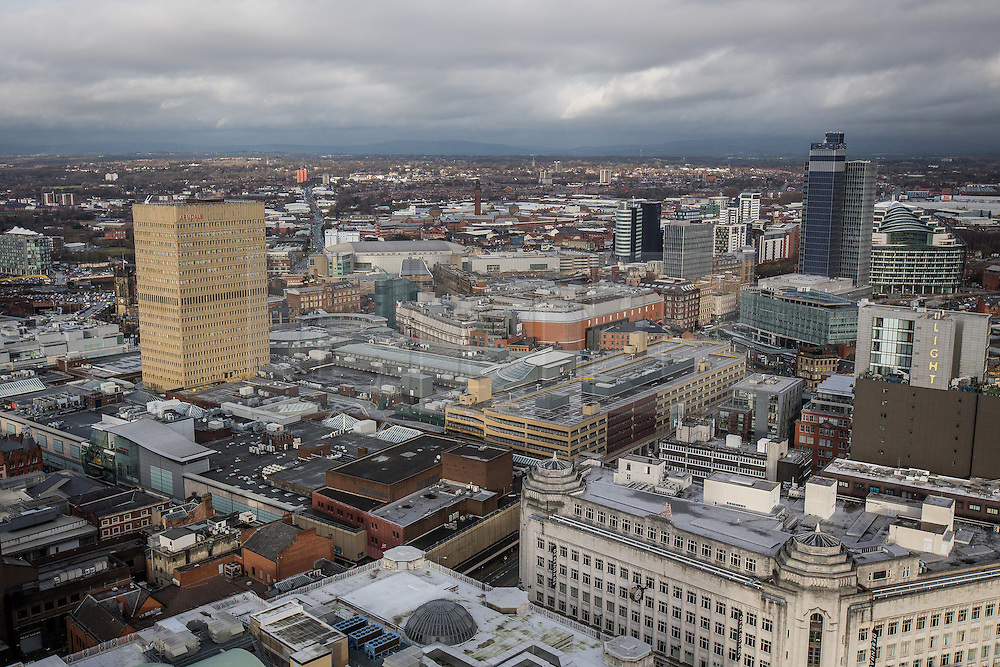 © Licensed to London News Pictures . 07/12/2013 . Arndale Centre (left and centre including Arndale Tower on the left), Co-operative ( CIS tower and Noma development including 1 Angel Square on the right) , Debenhams (bottom right) . Cityscape view of Manchester . Photo credit : Joel Goodman/LNP