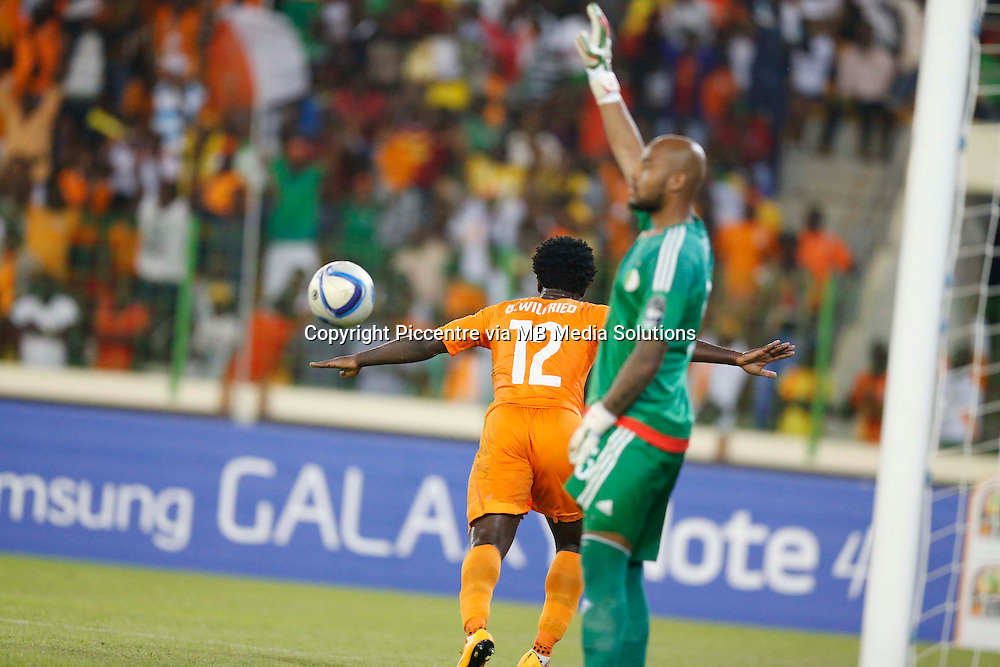 Wilfried Bony of Ivory Coast celebrate his goal against Algerian Keeper Azzeddine Doukha  during their AFCON 2015 Quarter Finals Match on February 1 2015 at Estadio de Malabo Equatorial Guinea. Photo/Mohammed Amin/www.pic-centre.com (Equatorial Guinea)