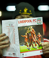 LIVERPOOL, ENGLAND - Wednesday, December 15, 2010: A Liverpool supporter reads a match-day programme before the UEFA Europa League Group K match against FC Utrecht at Anfield. (Photo by: David Rawcliffe/Propaganda)