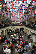 Covent Garden adorned with union jacks for the Queen's Diamond Jubilee weeks before the Olympics come to London, the UK gears up for a weekend and summer of pomp and patriotic fervour as their monarch celebrates 60 years on the throne. Flags and bunting adorn towns and villages too.