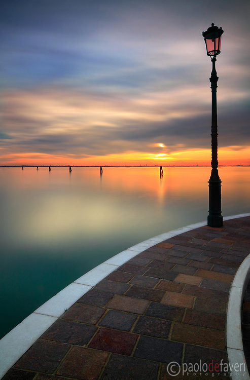 A view of the Venetian Lagoon at sunset, taken at the beginning of December from the harbour of the small island of Burano.