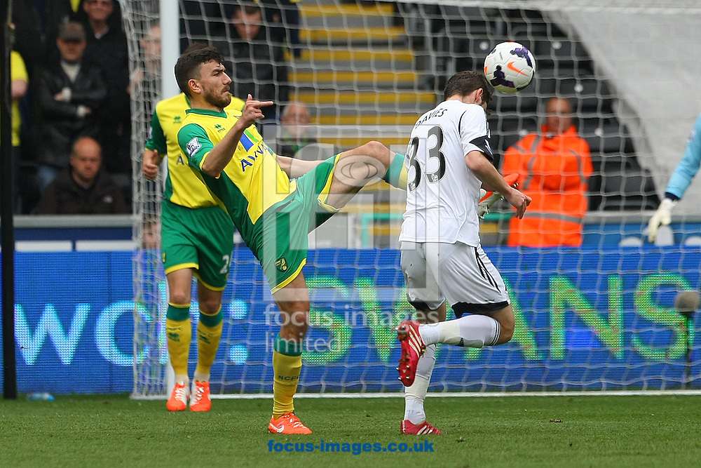 Robert Snodgrass of Norwich and Ben Davies of Swansea in action during the Barclays Premier League match at the Liberty Stadium, Swansea<br /> Picture by Paul Chesterton/Focus Images Ltd +44 7904 640267<br /> 29/03/2014