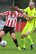 Jack Munns and Gary Jones during the Vanarama National League match between Cheltenham Town and Southport at Whaddon Road, Cheltenham, England on 15 August 2015. Photo by Antony Thompson.