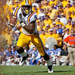 October 8, 2011; Baton Rouge, LA, USA; LSU Tigers running back Alfred Blue (4) runs against the Florida Gators during the first quarter at Tiger Stadium.  Mandatory Credit: Derick E. Hingle-US PRESSWIRE / © Derick E. Hingle 2011