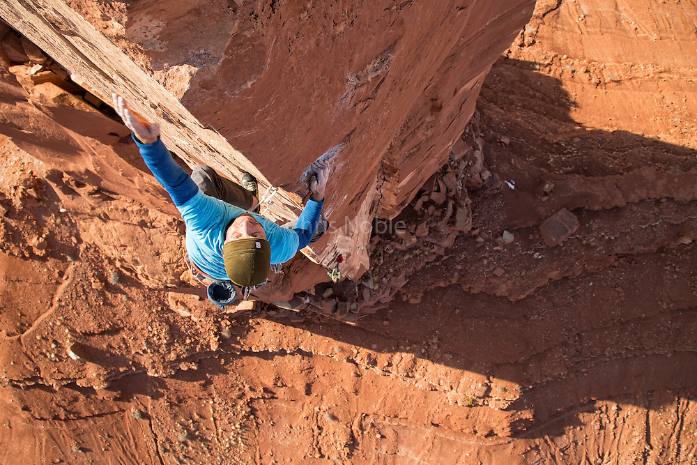 "Climber and podcaster Chris Kalous climbing his route (equipped by Sam Lightner) ""The Ivory Tower ""(13b) on Castleton Tower in Southern Utah."