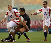 2005 Rugby, Investec Challenge, England vs New Zealand, Dan Carter, tackled by Jamie Noon, left standing back Mike Tindell and right Charlie Hodgeson,  RFU Twickenham, ENGLAND:     19.11.2005   © Peter Spurrier/Intersport Images - email images@intersport-images..