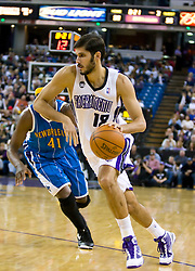 November 29, 2009; Sacramento, CA, USA;  Sacramento Kings forward Omri Casspi (18) dribbles past New Orleans Hornets forward James Posey (41) during the third quarter at the ARCO Arena.  Sacramento defeated New Orleans 112-96.