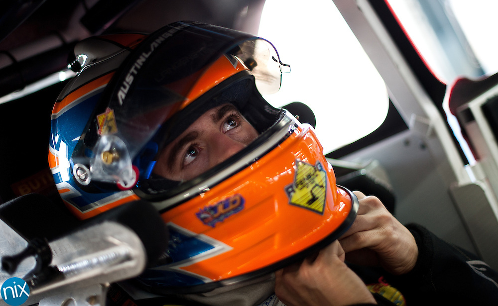 Racer Austin Langenstein, who races in the Legend car semi-pro division, gets ready to go out on the track during the Summer Shootout Tuesday night at Charlotte Motor Speedway. Langenstein comes from a racing family, his father, Charlie, used to race and currently works with Jimmie Johnson's team at Hendrick Motorsports. Austin hopes to move up from racing Legend cars onto bigger cars and tracks. Log on to Independenttribune.com to for Part 4 of the Summer Shootout video series. (Photo by James Nix)