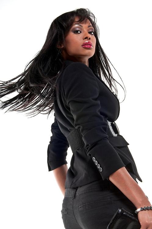 Young hispanic model in runway setting, isolated.