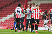 Brentford Head Coach Thomas Frank  celebrates with Brentford forward Josh Dasilva (14) at full time during the EFL Sky Bet Championship match between Brentford and Charlton Athletic at Griffin Park, London, England on 7 July 2020.