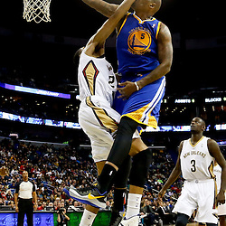 Nov 26, 2013; New Orleans, LA, USA; New Orleans Pelicans power forward Anthony Davis (23) fouls Golden State Warriors power forward Marreese Speights (5) on a dunk during the second half of a game at New Orleans Arena. The Warriors defeated the Pelicans 102-101. Mandatory Credit: Derick E. Hingle-USA TODAY Sports