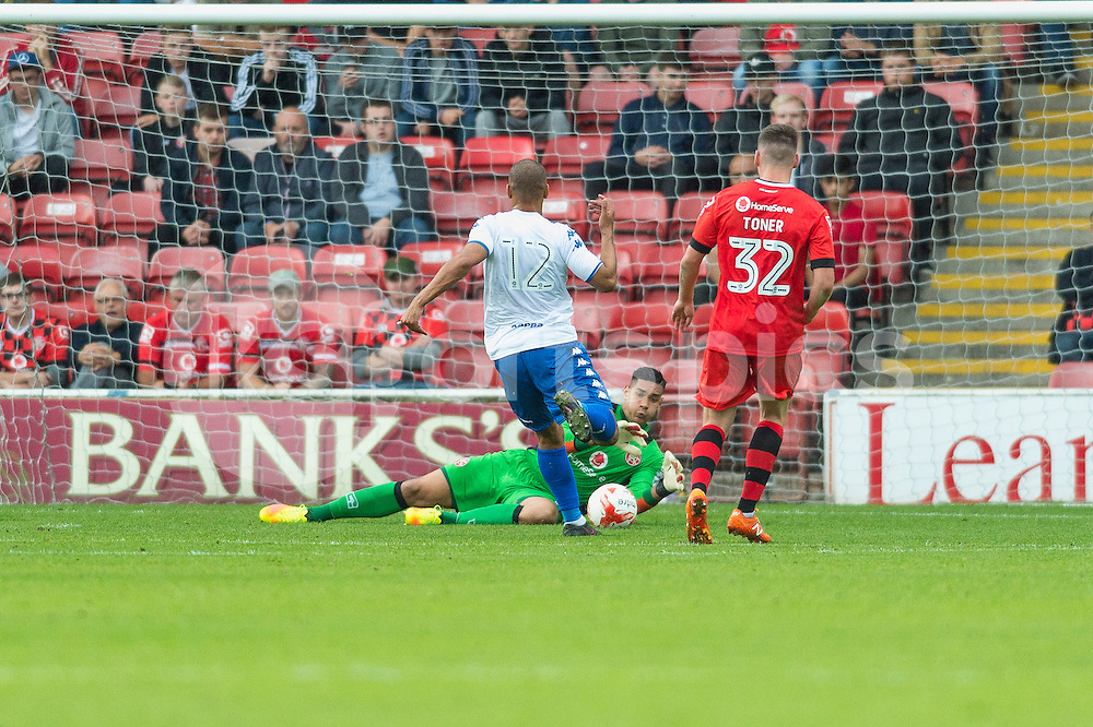 Neil Etheridge of Walsall  gathers the ball at the feet of James Vaughan of Bury during the EFL Sky Bet League 1 match between Walsall and Bury at the Banks's Stadium, Walsall, England on 27 August 2016. Photo by Darren Musgrove.
