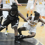 Trask's Saniyyah Mccallister and Topsail's Brandy Williams scramble for a loose ball Friday December 5, 2014 at Topsail High School in Hampstead, N.C. (Jason A. Frizzelle)