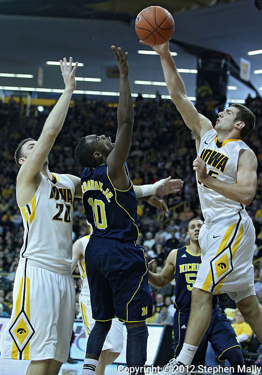 January 14, 2011: Iowa Hawkeyes guard/forward Eric May (25) blocks a shot by Michigan Wolverines guard Tim Hardaway Jr. (10) as Iowa Hawkeyes forward Andrew Brommer (20) looks on during the NCAA basketball game between the Michigan Wolverines and the Iowa Hawkeyes at Carver-Hawkeye Arena in Iowa City, Iowa on Saturday, January 14, 2011. Iowa defeated Michigan 75-59.