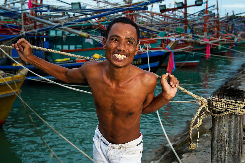 A Fisherman, having fun while waiting to head out.