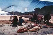 Man sunbathing, Middle East Tek, Wadi Rum, Jordan, 2008