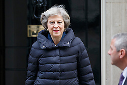 © Licensed to London News Pictures. 11/01/2017. London, UK. Prime Minister THERESA MAY leaving Downing Street in London to attend Prime Minister's Question Time on Wednesday, 11 January 2017. Photo credit: Tolga Akmen/LNP