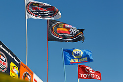 ROSEVILLE, CA - OCTOBER 13: General view of NASCAR flags flying above the grandstand  during practice for the NASCAR K&N Pro Series West Toyota/NAPA 150 at the All American Speedway on October 13, 2012 in Roseville, California. (Photo by Jason O. Watson/Getty Images for NASCAR) *** Local Caption ***