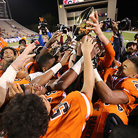 Adam Robison   BUY AT PHOTOS.DJOURNAL.COM<br /> Calhoun City players celebrate as they hold up their MHSAA Class 2A Football State Chanpionship Trophy after defeating Bay Springs 22-8 Friday in Strakville.