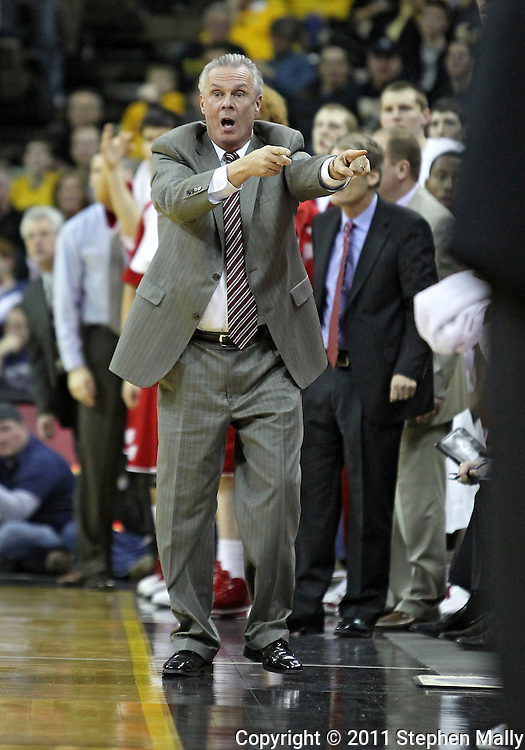 February 09 2011: Wisconsin Badgers head coach Bo Ryan yells at an offical during the first half of an NCAA college basketball game at Carver-Hawkeye Arena in Iowa City, Iowa on February 9, 2011. Wisconsin defeated Iowa 62-59.
